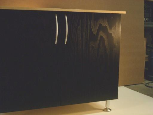 Close up of grain in black ash cabinet