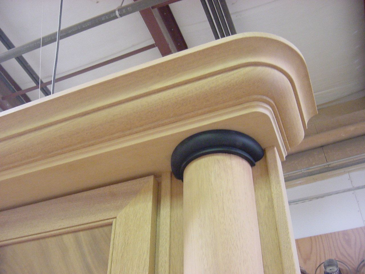 Cabinet top, crown, and column capital.